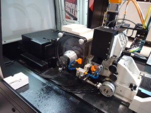 Hi-Accuracy system showing CNC dresser, SBS balancer, and CNC Regulating wheel dresser